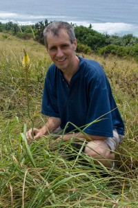 Photograph of Chris Whitehouse with Kniphofia