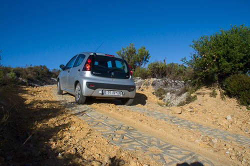 Peugeot 107 driving up the new road to Phillipskop self-catering cottages