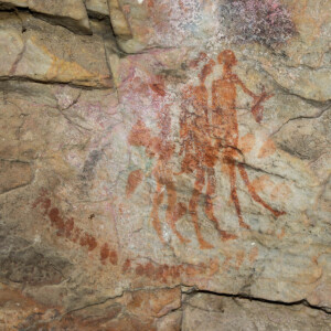 Rock art depicting group of men