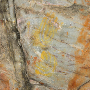 Rock art handprints in yellow
